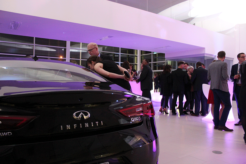 Customers exploring the Infiniti Q60 at The Guelph Infiniti Grand Opening Event