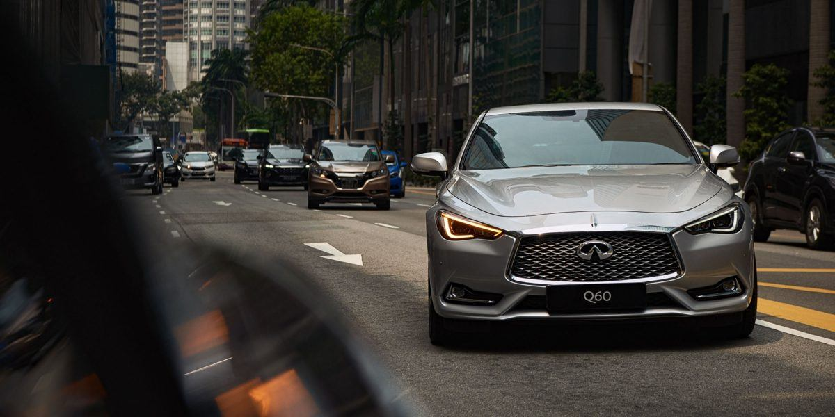 2020-infiniti-q60-coupe-design-driving-on-the-road-front-view.jpg.ximg.l_12_m.smart
